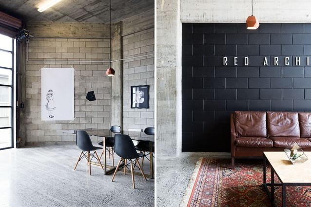 Leather sofa, wool rugs and terracotta pendant lights act as foils to the hard, industrial surfaces.