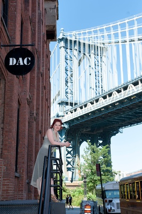 Zannah Mass in front of the Manhattan Bridge with DAC in foreground.