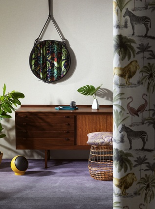 Image 2. Animal prints and dark timbers inspire this warm and inviting space.