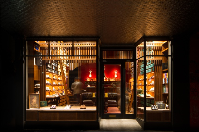 Chesterfield sofas, wooden ladders and low lighting make this store appear like a Victorian smoking lounge.