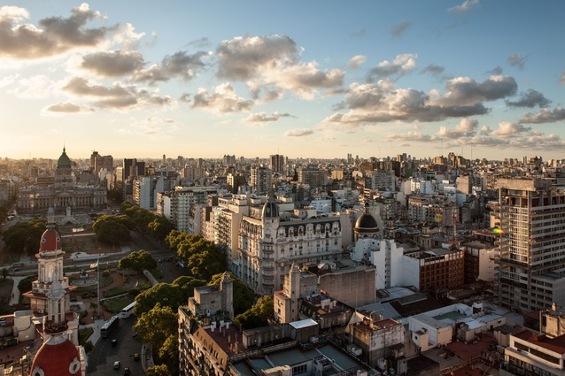 As the sun begins to set over Buenos Aires the light turns from warm white to iodine orange. This view from the small light house at the top of the Barolo Palace shows a city influenced by grand, European ideas of elegance and eclecticism.