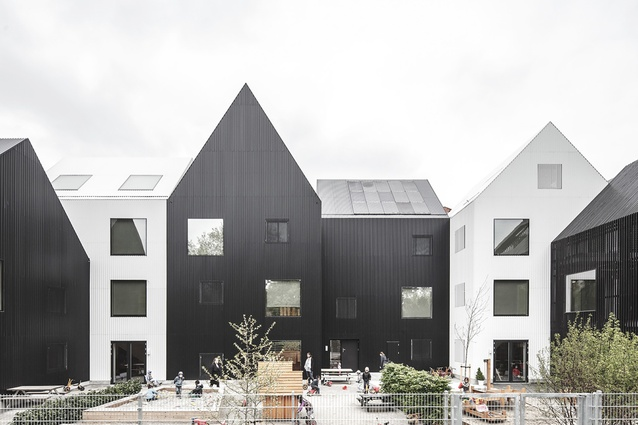 Frederiksvej Kindergarten by COBE, Denmark. The building is divided into 11 houses to create a small-scale village atmosphere, where children can establish their own play niches.