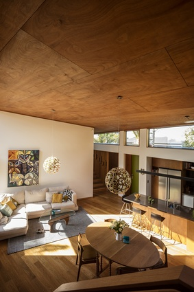 Tawini House interior. The large, single protecting roof plane is lined with warm plywood and creates a sense of containment and enclosure.