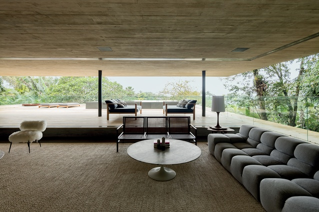 The sofas that line the living room are Tufty-Time by Patricia Urquiola and the coffee table is by Eero Saarinen. The fluffy white armchairs are Nepal Little by Paola Navone.