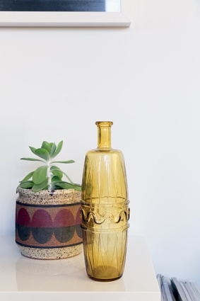 "Amber glass vase: ""I have to confess, that's stolen,"" says Smidt. Sort of. When the packers collected all their belongings from their London flat, this piece of glassware went along for the ride."