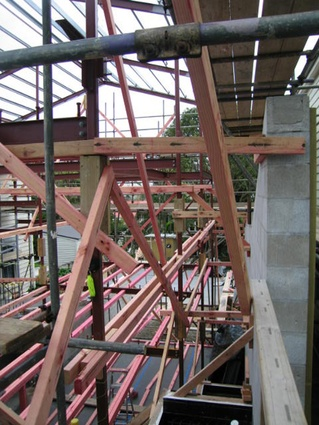 Timber framing within a steel structural frame.