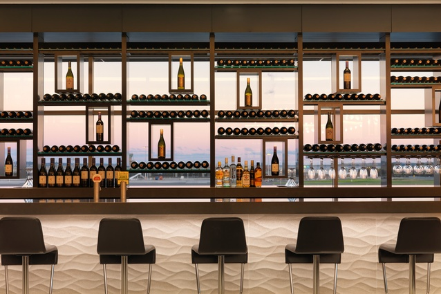 Framed views through to the taxiway and beyond, and an extensive selection of premium New Zealand vintages, make the Wine Wall the central space of the Sydney Koru Lounge.