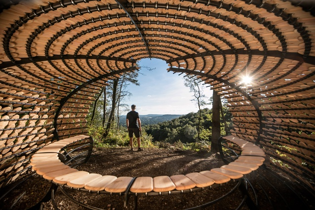 Perspectives installation. Designed as a rest stop for hikers, the cedar wood architecture references organic shapes and is inspired by the beautiful natural surroundings.