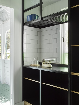 Detailing in the kitchen is respectful to the existing Queenslander, yet is distinct as new elements.