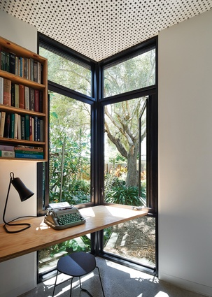 A combined home office and bedroom at the far end of the extension can be shut down completely as required.