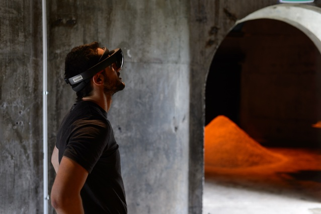 Guests enjoying the VR headsets at the Atelier Aitken and ArchitectureNow biotechnology in architecture exhibition at Silo 6, Wynyard Quarter.