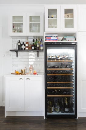 Home bar: The largest and possibly most significant addition to the house that's well stocked with interesting bottles and the fixings for Sid's beloved gin and tonics.