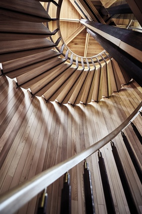 A cedar-clad drum contains the staircase, which is the one solid form in the building.