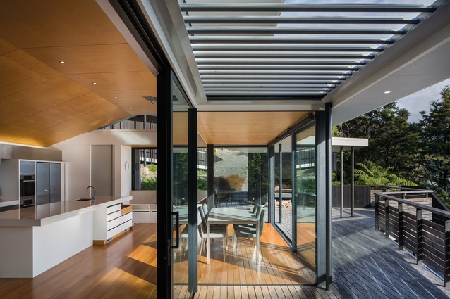 The kitchen and dining area opens straight onto a decking area.