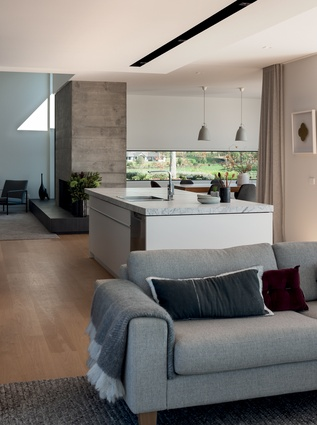 In the interior, concrete chimneys, marble and linen provide a serene and tactile palette.