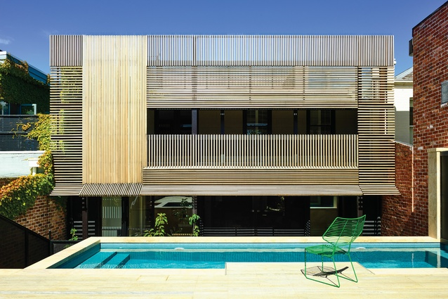 A battened timber screen creates a striking facade while also providing shade and privacy.