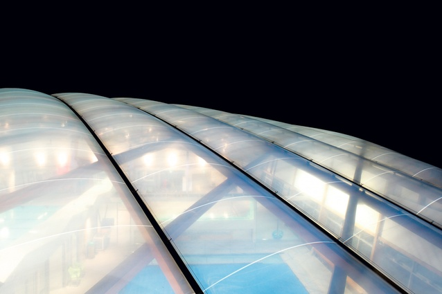 A triple-layer ETFE dome crowns the pool complex.
