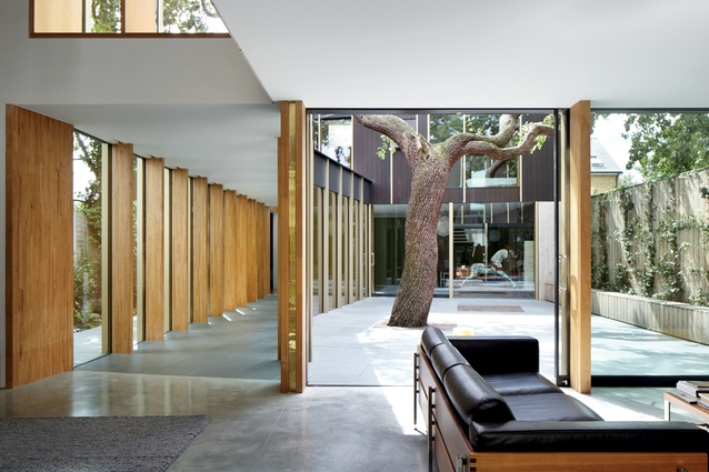 The view from the sitting room into the courtyard and walkway reveals the spacious, well-conceived nature of the plan.