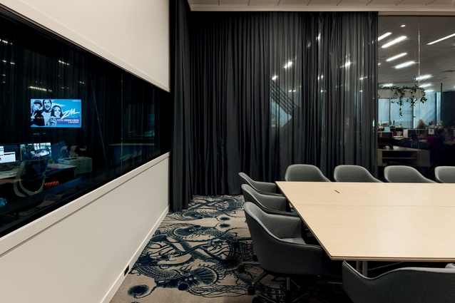 From the boardroom, meeting-goers have a view of the radio studios.