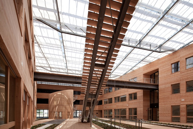 French National Solar Energy Institute. The glass roof is designed on a north-south axis to maximise the use of the sun and regulate the temperature inside the atrium.