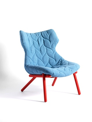 Foliage armchair in blue with red legs.