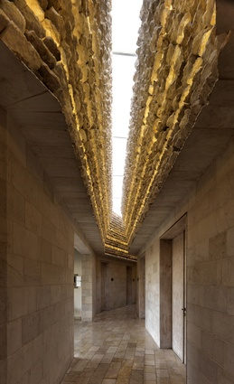 Royal Academy for Nature Conservation, Ajloun, Jordan. A crack in the ceiling of the corridors creates a contrast of light and shadow on the interior limestone cladding.