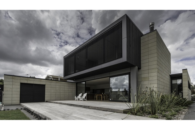 Arran Road residence. Darkly stained cedar boards are offset by the soft Hinuera stone.
