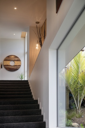 The view from the front entrance up the staircase/corridor to the back wing of the house.