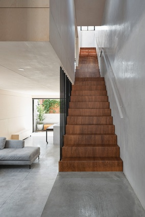 Polished plasterboard, its shimmering finish created by marble dust, lines the wall to the stairs.
