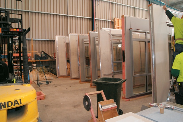 Cladding is applied to vertical panels.