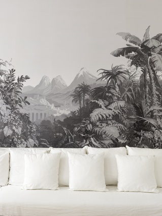 One of the walls is covered in a panoramic grisaille paper from Zuber.