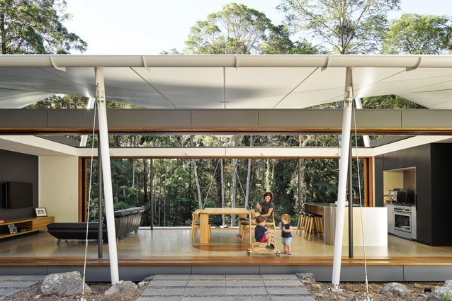 For most of the year, responding to the climate on the Sunshine Coast, the house operates as an open platform sheltered by a fabric roof.