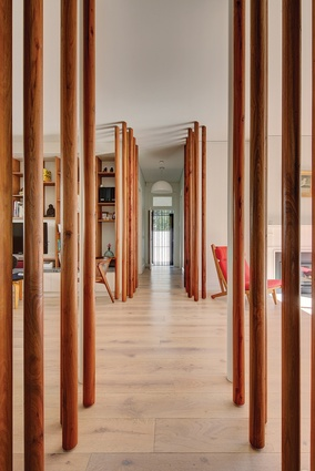 """The most striking feature of the interior is a series of narrow """"tree trunks"""" that run down each side of the central hall."""