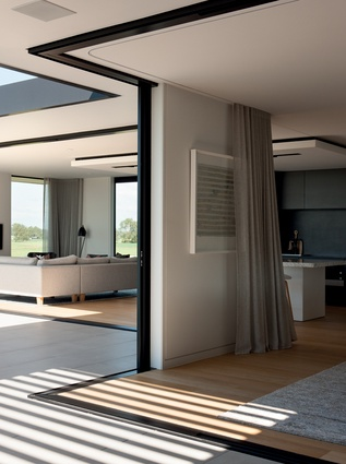 Level entry transitions between indoor and outdoor areas dissolve the sense of separation between spaces.