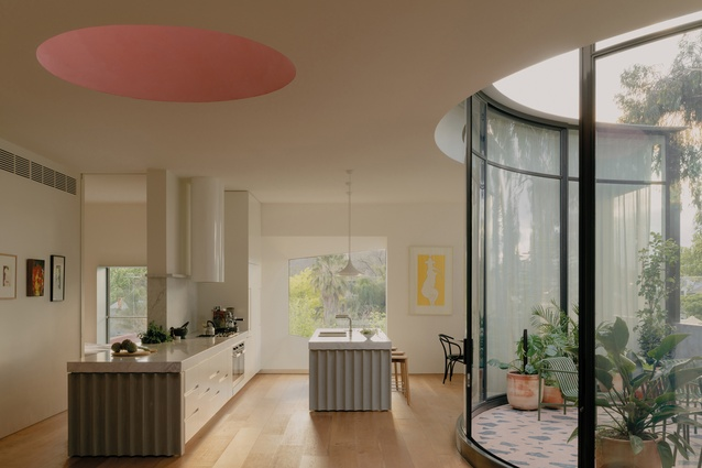 The understated kitchen occupies a small nook in the living area's open plan.