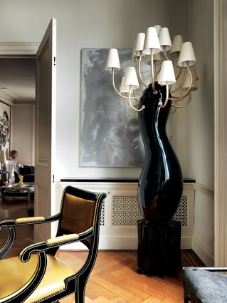 A Garouste & Bonetti torchére takes pride of place in the dining room.