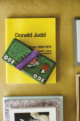 "Donald Judd book and Drug Money artwork by Camp Bosworth. ""Donald Judd revived this dying town in Texas called Marfa. He used to be an art critic. The money stack is also from Marfa."""