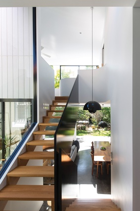 The extension has a split-level relationship to the original house, clearly defining old and new parts.