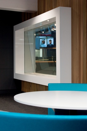 Glass-walled studios offer direct views to news delivering monitors around the rest of the hub.