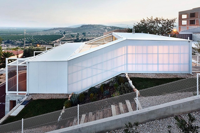 Seasonless House by Casos de Casas. Built in Spain in 2013. The home's double walls made from cellular polycarbonate means that the house feels open and closed at the same time.