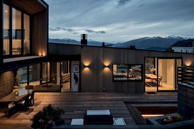 The design of the outdoor living space is uncluttered and accentuates the surrounding scenery.