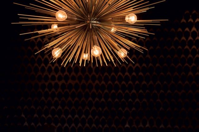 A starburst pendant in the private dining room.
