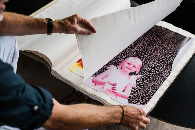 "Family photo art. ""I gave a pile of our children's photos to an artist and told him to go nuts. I filled this huge parchment book with all the prints for Kate's 40th birthday."""