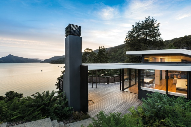 The main decked area and barbecue area leads directly into the living area and then winds down to the water's edge.