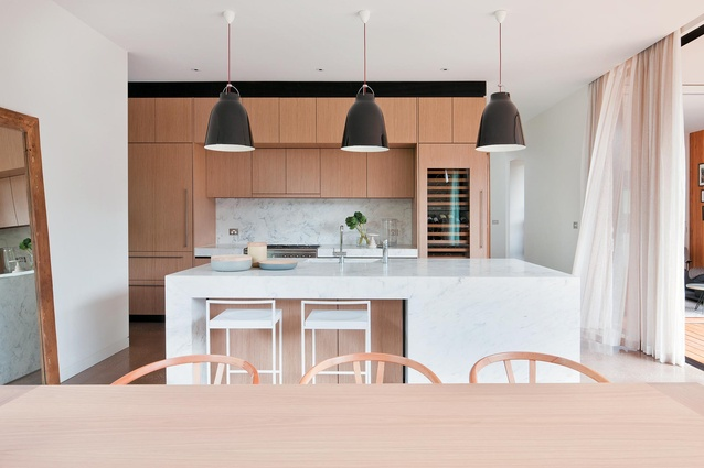 Inside, the light-filled kitchen combines a feminine, soft palate with industrial touches.