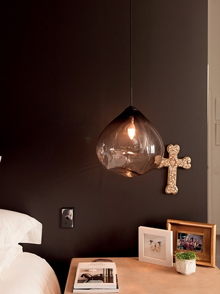 """Parison pendant lights: """"Their unusual shape creates really lovely crystalline patterns on the walls. Also, John loves to read in bed and I find these are easier to sleep with."""""""
