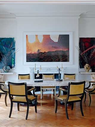 A Richard Prince photograph hangs above the dining table.