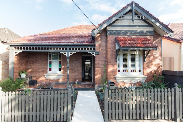 From the street, the addition is barely discernible and the building reads as a modest, single-storey home.