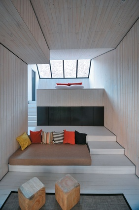 Looking from the living space to the bedroom and views beyond.