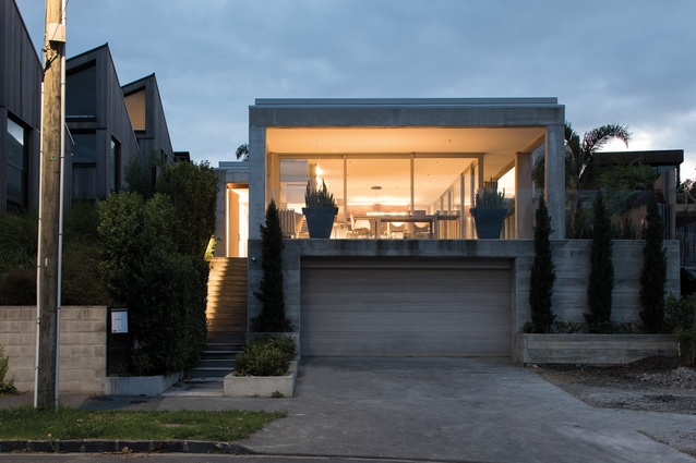 Poured House, Auckland, 2015. The front street elevation features a huge sheltered verandah.